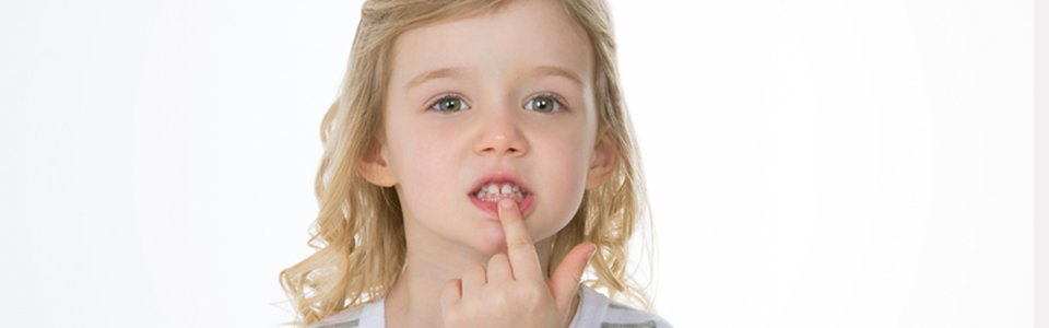 Toddler pulling her lower lip down with her finger
