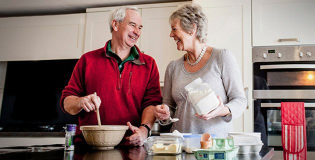Elderly couple cooking together in the kitchen